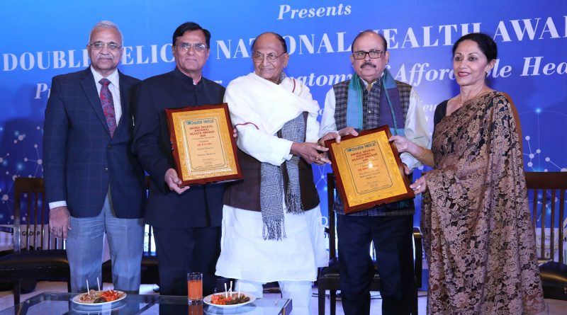 "Dr.(Prof.) R K Tuli receiving National Award from Dr. C P Thakur, former Union Minister of Health for Excellence in Pioneering Holistic Medicine in India and highlighting its benefits for ""AFFORDABLE HEALTH FOR ALL"""